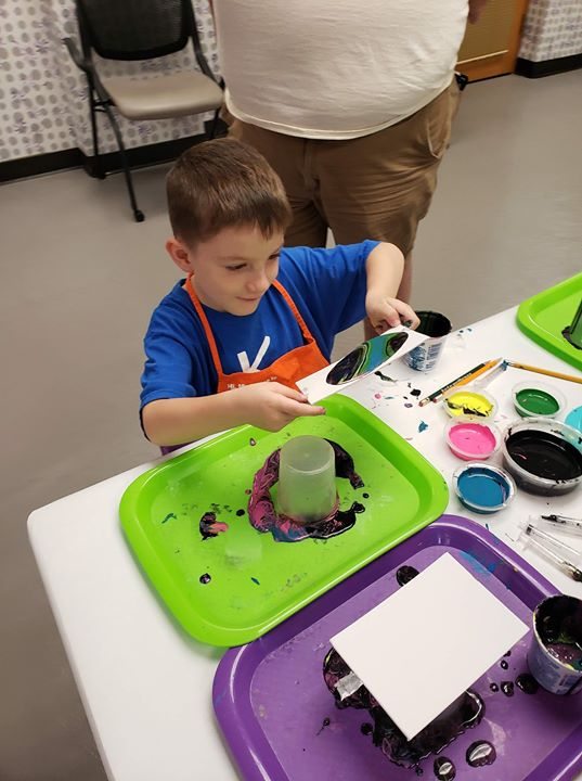 Today in astro artists we made galaxies by pour painting! It was a very fun messy day!